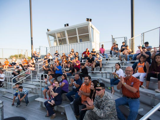 Fans gather to support the Beeville softball team before