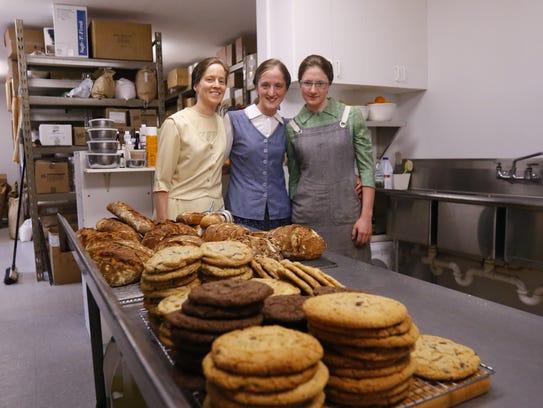 Gretel Bahler, left, her sisters Beka, and Simone,