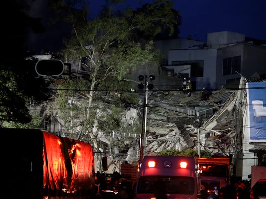 Rescue workers continue to search through rubble in
