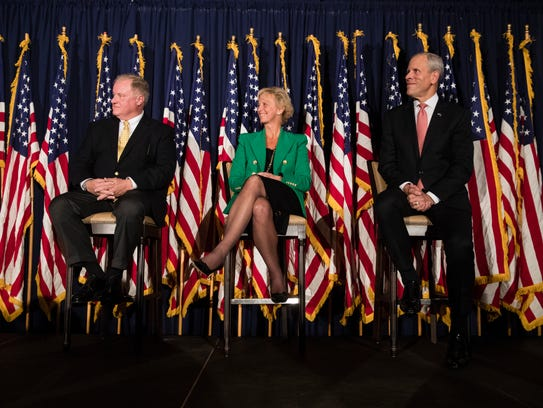 Candidates from left, seeking the Republican Party's nomination to challenge Democratic Gov. Tom Wolf's re-election bid, Pennsylvania Sen. Scott Wagner, R-York County, Laura Ellsworth and Paul Mango take part in the Montgomery County Republican Committee gubernatorial forum in Blue Bell, Pa., Thursday, Oct. 19, 2017.