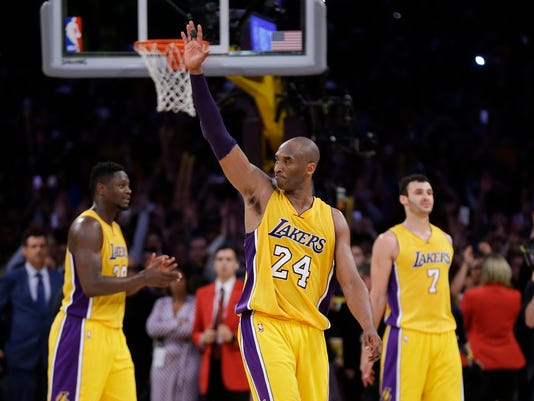 Los Angeles Lakers' Kobe Bryant acknowledges the fans after the last NBA basketball game of his career, against the Utah Jazz on Wednesday, April 13, 2016, in Los Angeles. Bryant scored 60 points as the Lakers won 101-96. (AP Photo/Jae C. Hong)