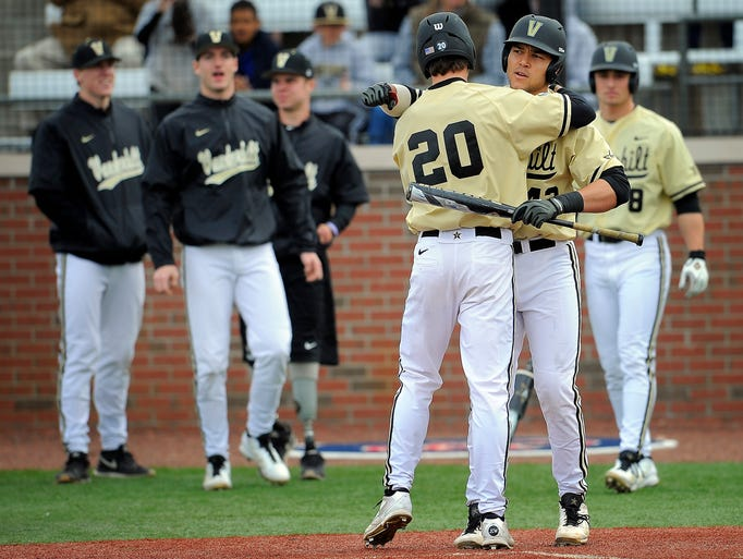 Bryan Reynolds (20)  is congratulated for his home run by teammate Zander Wiel as he come home as Vanderbilt plays Belmont at Rose Park Tuesday March 18, 2014, in Nashville, TN.