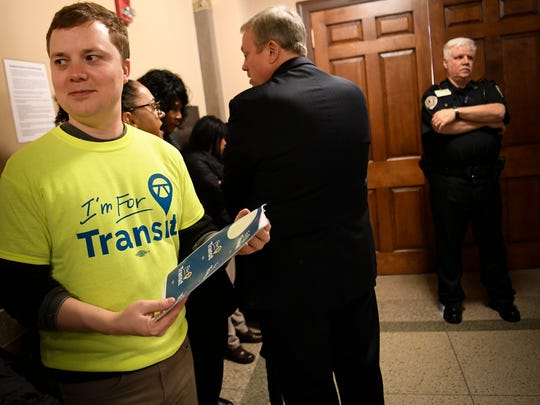 Transit supporter Adam Nicholson waits in the lobby outside the David Scobey Council Chambers with other constituents to observe the Metro Council meeting at the Metro Courthouse Tuesday, Feb. 6, 2018 in Nashville, Tenn. The gallery was too full to accommodate many of the constituents wanting to observe the meeting.