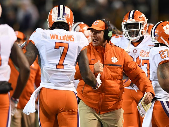 Clemson head coach Dabo Swinney celebrates with wide receiver Mike Williams (7) after Williams caught a touchdown during the first quarter at Wake Forest's BB&T Field on Saturday.