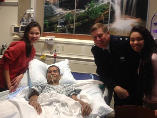 Maj. Gen. Edward W. Tonini, Kentucky's adjutant general, visits with Capt. Noel Espino and his wife, Rose (left) and daughter Jasmine.