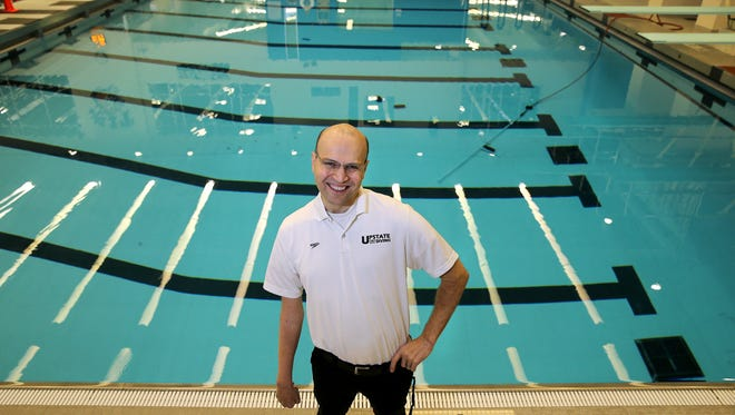 Cliff Devries, partially paralyzed after a medical setback, found newfound happiness as diving coach at Rochester Institute of Technology.