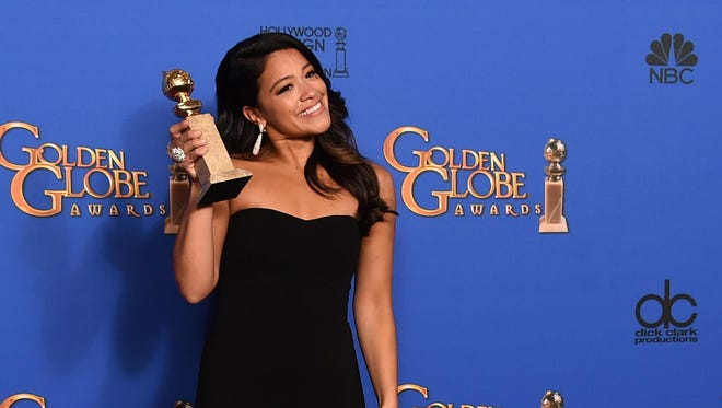 """In this Jan. 11, 2015 file photo, Gina Rodriguez poses in the press room with the award for best actress in a television series - musical or comedy for """"Jane the Virgin"""" at the 72nd annual Golden Globe Awards in Beverly Hills, Calif."""