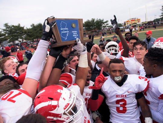 Delsea celebrates a 29-28 victory over Woodrow Wilson,