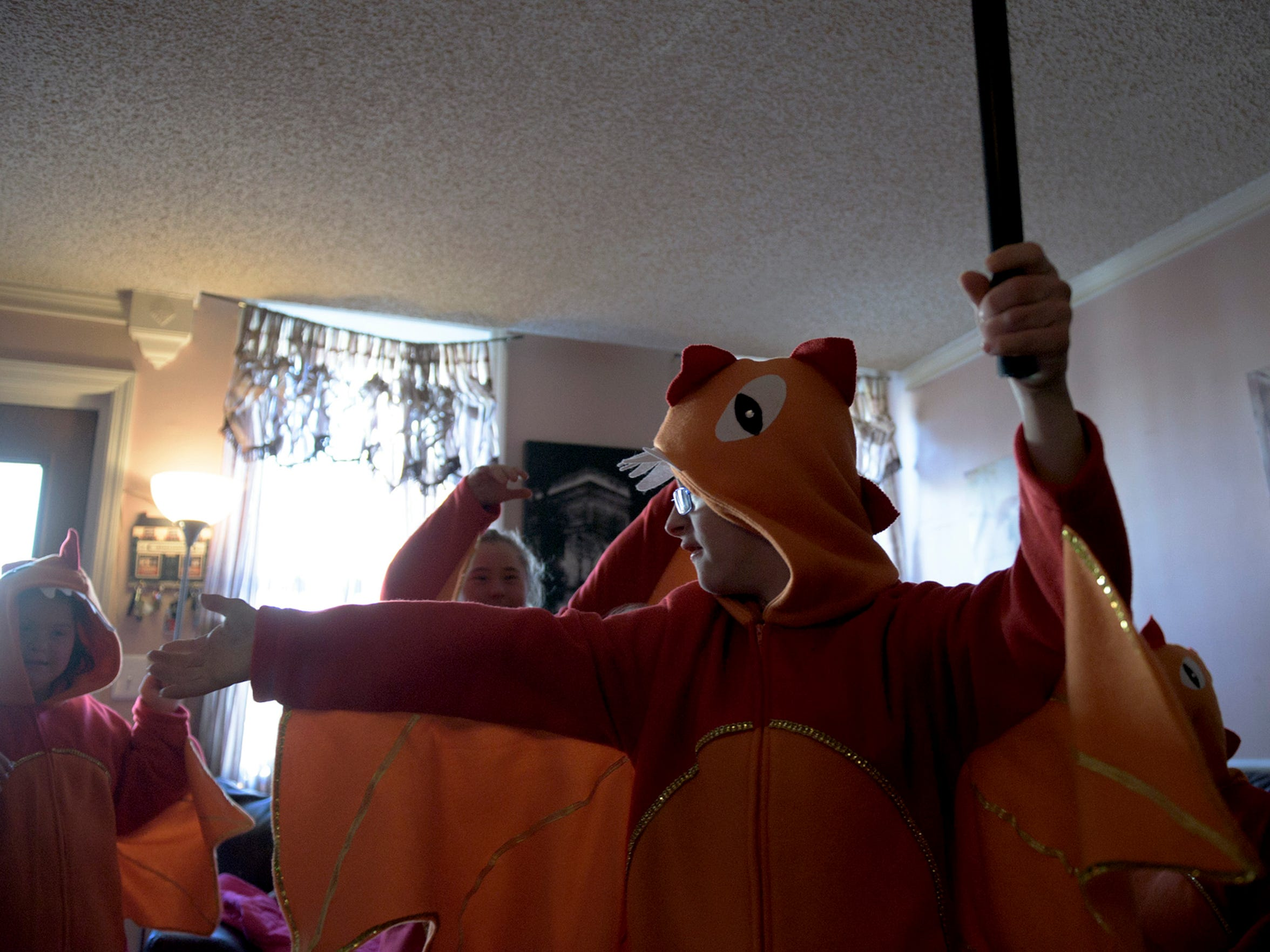 Christopher Sferra, 18, carries a staff to match his dragon themed Mummers costume.