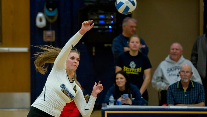 SC4's Kendall Stoll spikes the ball during a volleyball game Tuesday, October 21, 2015 at the St. Clair County Community College gymnasium.
