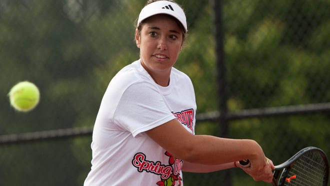 FILE -- Brooke Austin, 17, practices with her tennis team on Friday, June 7, 2013, at Center Grove High School in Greenwood, Ind.