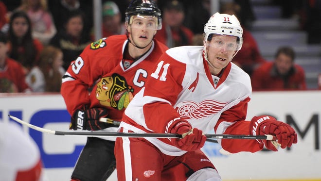 Detroit Red Wings right wing Daniel Alfredsson (11) looks for the puck against the Chicago Blackhawks.