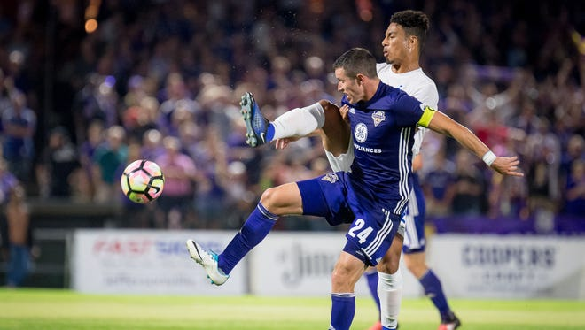 Louisville City  defender Kyle Smith (24) plays against FC Cincinnati midfielder Marco Dominguez (21) during the game played in Louisville, Ky., Saturday, August 12, 2017.  (Photo Bryan Woolston)