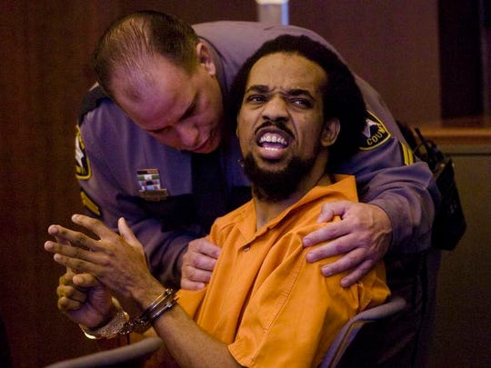Mesac Damas during a 2011 courtroom outburst. He is accused of killing his wife and five children in 2009.