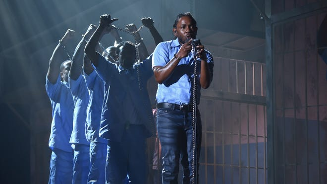 Kendrick Lamar performs onstage during The 58th GRAMMY Awards at Staples Center on February 15, 2016 in Los Angeles, California.  (Photo by Larry Busacca/Getty Images for NARAS)