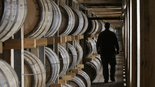 A worker walks on the fifth floor of a  warehouse at the Jim Beam Booker Noe plant.  The warehouse is almost filled up with newly aging bourbon.  Jim Beam is spending millions to increase capacity.