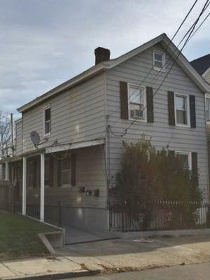 A two-family home at 75 Clinton St., in Sleepy Hollow received a $4,450 state grant last year from a local development corporation headed by a village trustee. The home belongs to Village Attorney Janet Gandolfo, an influential Democratic leader and past mayor.
