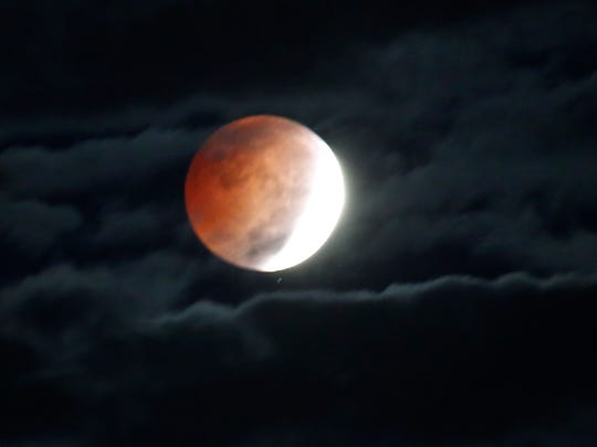 The moon is eclipsed by the earth creating a glow as seen from Cortlandt on Oct. 8, 2014