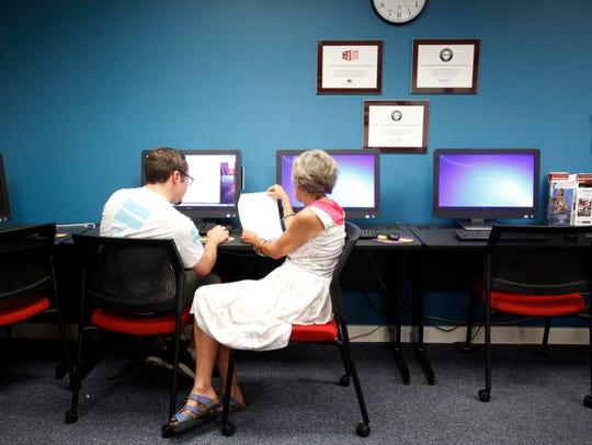 Daniel Gill, a freshman at A-B Tech, refines an essay