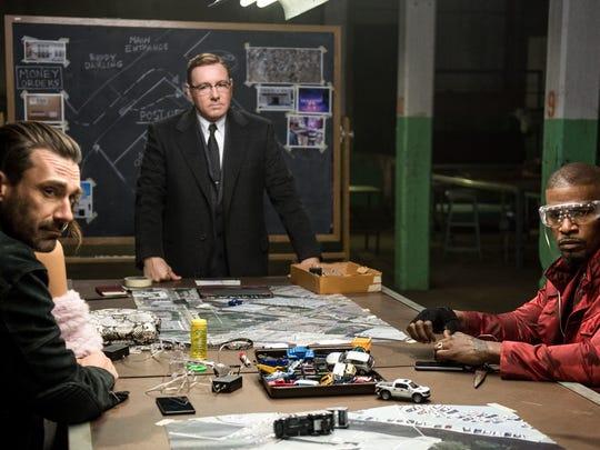 Doc (Kevin Spacey) lays out the heist plan to Buddy