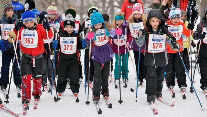 Children in the 6-, 7-, and 8-year-old bracket take off from the starting line Sunday, Jan. 24 during the Ninth Annual Sons of Norway Barnelopet at Riverside Park. Between 80 and 90 children participated in the nordic skiing event.