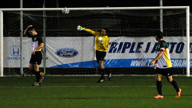 In this file photo from March, University of Guam Tritons goalie Michael Topasna tosses the ball back after one of his many stops Tuesday night in GFA men's league Division II action.
