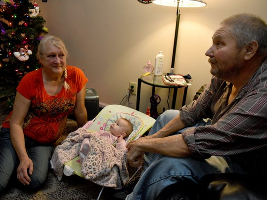 Tammy and Carl Bolling take care of their granddaughter Stella Rose in their home in Harriman on Thursday, Dec. 21, 2017.