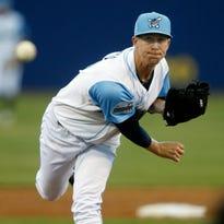 Blue Rocks hitter Mauricio Ramos follows through on his two-run double in the third inning at Frawley Stadium Friday.