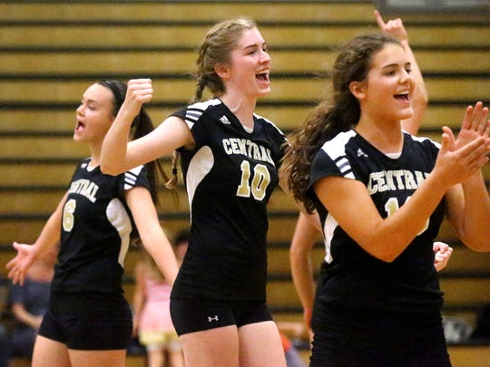 Central Magnet's Haylee Nicholson (6), Carolyn Peay (10) and Mary Catherine Smith (16) celebrate a point against Tullahoma Thursday.