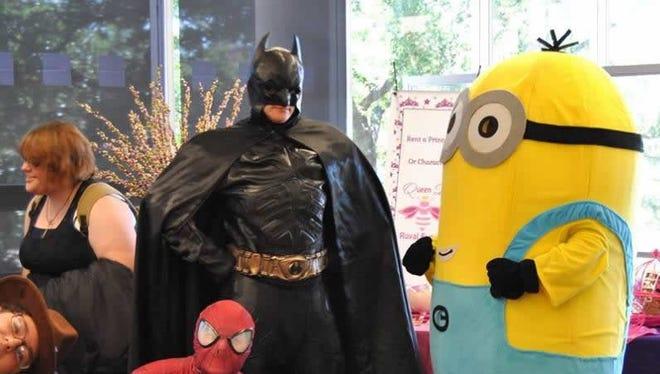 Batman, Spider-Man and a Minion converse at a previous Lib-Con.