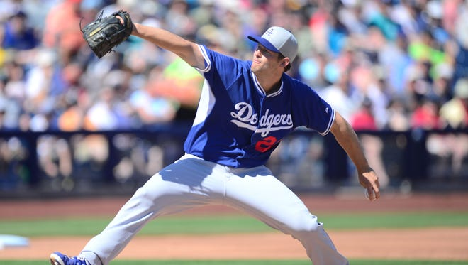 Los Angeles Dodgers starting pitcher Clayton Kershaw (22) pitches against the Seattle Mariners at Peoria Sports Complex in Peoria on March 15, 2015.