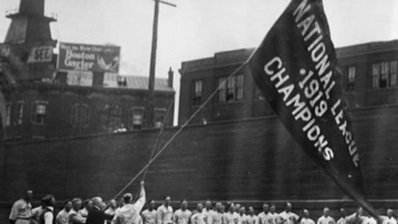 Early in the 1920 season, the Reds players hoisted