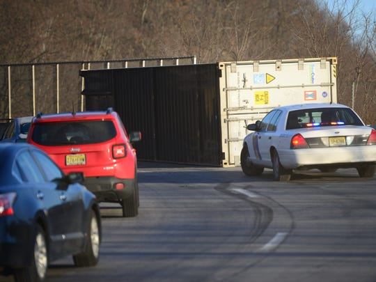 A shipping container rolled off its trailer on the I-287 fly-over at Route 17 Monday morning on January 16, 2017.  Tariq Zehawi/NorthJersey.com