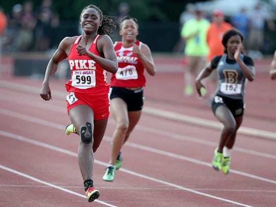 Pike's Lynna Irby (599) finishing in first place in the Girls 200 Meter dash during the girls IHSAA State Finals at Indiana University's Robert C. Haugh Track & Field Complex in Bloomington, Saturday, June 3, 2017.