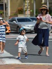 Tourists walk the streets of Tumon on Jan 4.