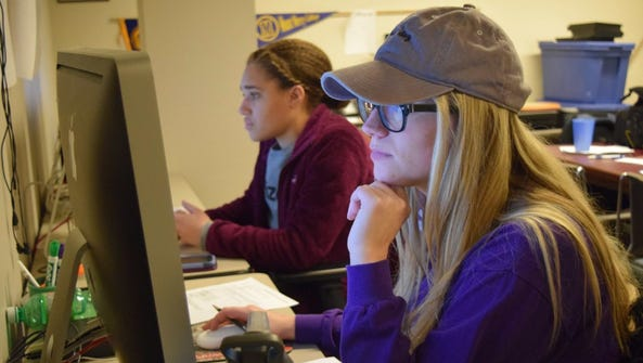 Mount Mercy Times editor in chief Brooke Woolley, right,