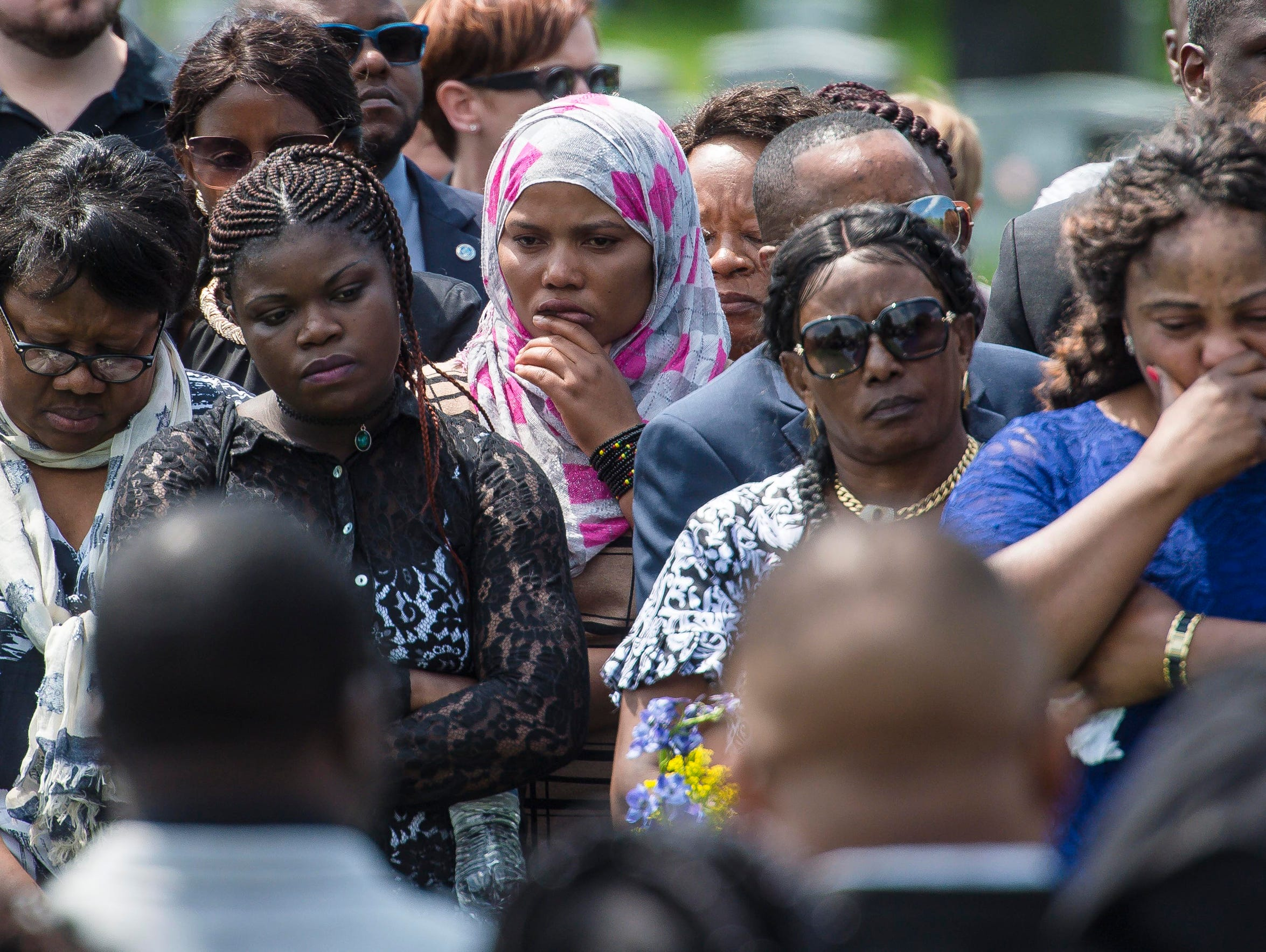 More than a hundred mourners attend the burial of Anako