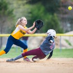Pocomoke second baseman Emely Martin (7) attempts to make a tag on Snow Hill shortstop Rylee Covingon (1) at the Worcester County Recreation Center in Snow Hill on Monday, April 25.