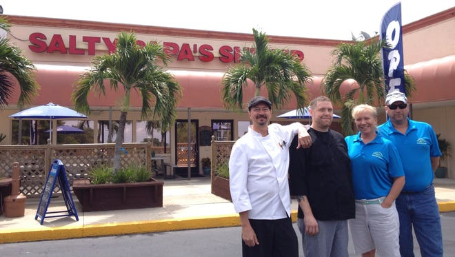 Salty Papa's Shrimp House opened in the former Pinchers Crab Shack in south Fort Myers. From left: chef Rick Lamoureux, chef Joe Voigt, and owners Vallee and Marc Arnett.