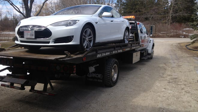 Robert Montgomery's Tesla is towed. He contends he had multiple problems with the car, qualifying it as a lemon.