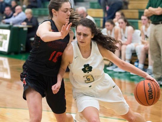 Knoxville Catholic's Rachel DeBaar drives towards the