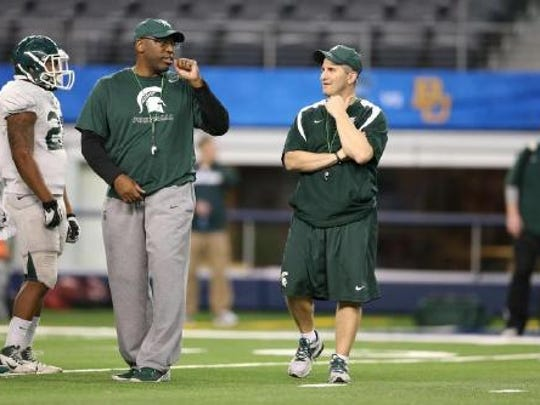 Harlon Barnett, left, and Mike Tressel, became MSU's co-defensive coordinators right after the Cotton Bowl on Jan. 1, 2015.