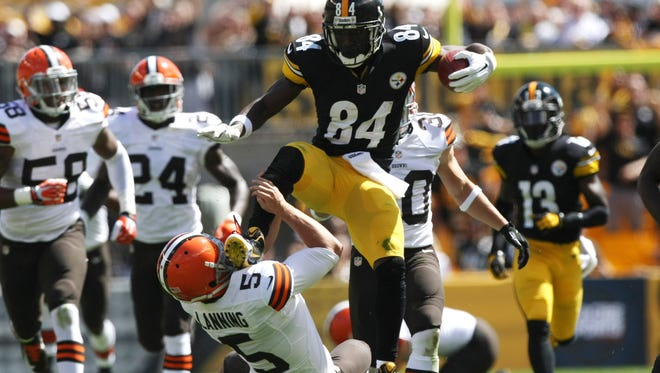 Steelers wide receiver Antonio Brown runs over Browns punter Spencer Lanning during the first half at Heinz Field on Sept. 7.