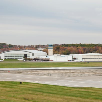 A view of runways at Stewart International Airport, including the air control tower at rear.