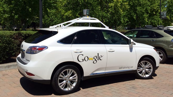 One of Google's driverless cars, based on a Lexus. The company is also busy building small two-person autonomous pods. Google said Thursday it's getting into the car insurance market in the U.S.