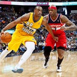Mar 23, 2014; Denver, CO, USA; Denver Nuggets power forward Darrell Arthur (00) dribbles the ball as Washington Wizards power forward Al Harrington (7) defends in the fourth quarter at the Pepsi Center. The Nuggets won 105-102. Mandatory Credit: Isaiah J. Downing-USA TODAY Sports