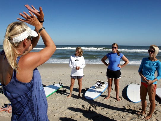 Michelle Sommers of Sommers Surf Lessons demonstrates