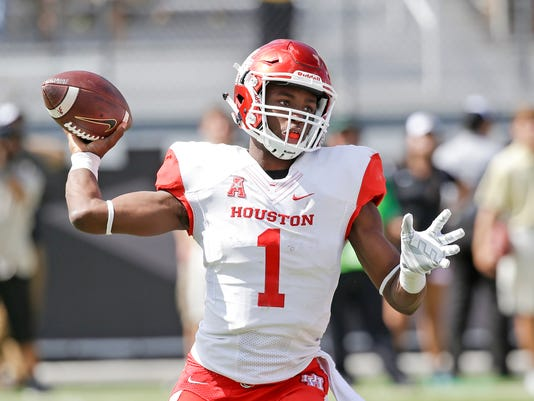 FILE - In this Oct. 24, 2015, file photo, Houston quarterback Greg Ward Jr. looks for a receiver against Central Florida during an NCAA college football game in Orlando, Fla. If Ward, who passed for 2,828 yards, ran for 1,108 yards and accounted for 38 touchdowns last season, has a big game against Oklahoma and leads the Cougars to an upset, he can vault himself into the heart of a crowded field of Heisman contenders that includes three of the top four vote-getters from last season. (AP Photo/John Raoux, File)