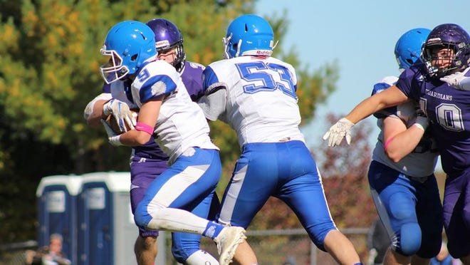 Recent Narragansett Regional graduate Patrick Fruit (53), shown blocking for teammate Zak Ramos during a game agianst the St. Peter-Marian Guardians last fall, played three seasons on the Warriors football team.