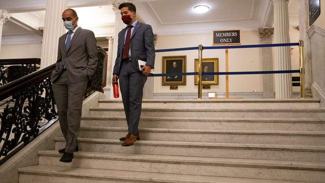 From left, Reps. Jon Santiago and Andy Vargas, members of the Black and Latino Legislative Caucus, were among the last to leave the chamber Wednesday night after the first day of House policing reform debate.